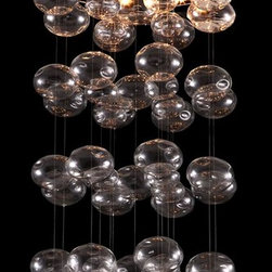Zuo Modern - Ceiling Lamp with Steel Base - Includes eleven 15 watt G4 halogen type bulb. UL listed. Warranty: One year limited. Made from glass and stainless steel. Clear color. Ceiling plate: 23.6 in. Dia.. Overall: 23.6 in. Dia. x 39.4 in. H (11 lbs.). Assembly InstructionHarmonious orbs hang from a polished stainless steel base. Halogen lights create the warm glow of the Vector ceiling lamp.