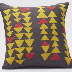 Triangle Row Pillow - Coyuchi specializes in sourcing organic and fair-trade materials. This appliqué pillow with great triangle beads is made in India with flax grown from France and Belgium — talk about a well-sourced product.