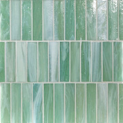 "Glass Tile Oasis - Cerulean Shimmer 1"" x 4"" Green Pool Glossy Glass - Sheet size:  1.05 Sq. Ft.   Tile Size:  1"" x 4""   Tiles per sheet:  36    Tile thickness:  1/4""   Grout Joints:  1/8""   Sheet Mount:  Paper Face    MADE TO ORDER-LEAD TIME 2 WEEKS     Sold by the sheet    - Brilliant transparent glass combed through with coordinating opaque colors  and featuring a contemporary smooth-edge. Each piece is hand-poured and unique  designed with a certain amount of variation and variegation of color  tone  texture and shade for a distinctive appearance. Our handmade process incorporates creases  wrinkles  waves  bubbles and other surface effects indicative of handmade glass  all designed to capture light and enhance the final beauty of the project."