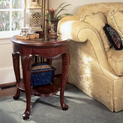 American Drew Cherry Grove Round End Table - For an elegant table with exquisite style, go with the American Drew Cherry Grove Round End Table. This ornate table features solid wood construction, a glass top, an antique cherry finish, and a lower display shelf.About American DrewFounded in 1927, American Drew is a well-established, leading manufacturer of medium- to upper-medium-priced bedroom, dining room, and occasional furniture. American Drew's product collections cover a broad variety of style categories including traditional, transitional, and contemporary. Their collections range from the legendary 18th-century traditional Cherry Grove, celebrating its 42nd year of success, to the extremely popular Bob Mackie Home Collection, influenced by the world-renowned fashion designer Bob Mackie. Jessica McClintock Home features another beloved designer bringing unique style to an American Drew line. American Drew's headquarters are located in Greensboro, N.C. Their products are distributed through thousands of independently owned retailers throughout the United States and Canada and around the world.