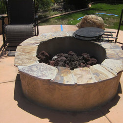 Home Repairs - Natural Stone Fire Pit installed in Existing pool area with Decorative Concrete Patio