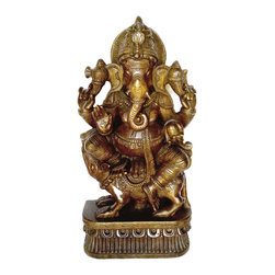 Wooden Ganesha - Dark Wood Finish 3 Ft - Ganesha or Ganesh is Hinduism's Lord of Beginnings and Remover of Obstacles.  This position is called Ekakshara Ganapati. Gam, the single syllable (Ekakshara) that is part of the Ganesha mantra Aum Gam Ganapataye Namah, invokes the blessings of the Lord. Ekakshara Ganapati is red-complexioned and adorned with red garments. Seated on Mooshika the mouse, Ganapati's one hand gestures blessings, while the other three hold the goad, noose and a pomegranate. The crescent moon and third eye are present too, in this form. This Ganesh sculpture is handcrafted by the wood artisans in South India.