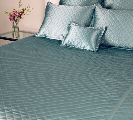 Quilted Coverlet - Twin - Aquamarine - A jewel of a bedding accent,  the Quilted Coverlet presents a diamond quilting pattern on 100% silk charmeuse. A soft lustre adds a whisper of elegance to bedscapes both modern and traditional, allowing for ease in blending with a range of textures, fabrics, and color palettes. The complementary coverlet backing is composed of a silk and cotton blend.