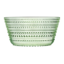 """iittala - Kastehelmi 8"""" Bowl - The Kastehelmi range of glassware that Toikka originally designed in 1964 was also the outcome of a technical challenge. To celebrate Toikka's 50th, Iittala reintroduced a selection of the most popular pieces in the range in year 2010. The idea of using droplets of glass as decoration came to Toikka when he was thinking of ways of covering the joint marks left on the surface of pressed glass pieces by the production process. Features: -Crafted of lead free crystal. -Perfect for serving or creating a beautiful centerpiece for your table. -Dishwasher safe. -Overall Dimensions: 3.91"""" H x 7.95"""" W x 7.95"""" D."""