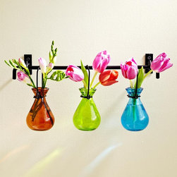 Hanging Glass Bud Vases - I like this hanging vase set because it allows you to do something different with color and flowers in a space. I think it would look terrific in a bathroom where there are no windows because it would almost light up a wall with the bright colors and flowers. The iron hanging bar is great looking too. Feels like spring.