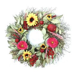 Grandin Road - Four Seasons Wreath - Delightful door, wall, or mantel decoration made for year-round display. Handcrafted from silk and air-dried florals, faux fruit, and natural twigs, with a metal base. 2+ year lifespan when displayed indoors or in a protected outdoor area, away from moisture and direct sunlight. Arrives ready to hang. Hang it up once, and enjoy the lasting beauty of our Four Seasons Wreath year round. Thoughtfully designed with distinctive materials that each represent one of the four seasons: Spring (silk sunflowers), Summer (silk gerbera daisies), Autumn (faux fruits), and Winter (natural quail brush twigs). Two types of berries add a touch of pizzazz and pay homage to the holidays, and seeded eucalyptus is blended throughout. Everything is professionally hand-arranged, then secured to a sturdy metal clamp ring. Each wreath is meticulously and individually crafted, so no two are exactly alike.  .  .  .  .