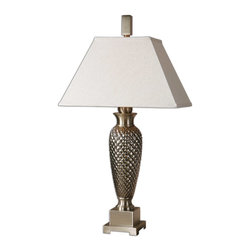 Uttermost - Everson Ceramic Lamp - A slim pineapple has come to visit you and it's calling itself a lamp. Sure, it looks like a lamp with the plated metallic silver finish and brushed champagne metal details. And it does have a lovely metal finial and base, but you know a pineapple when you see it. Don't you?