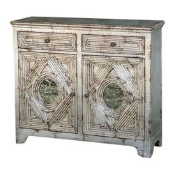 Uttermost Emrick Console Cabinet - Distressed silver leafing and antiqued mirrors accent the style of this spanish colonial cabinet with two dovetail drawers, one interior shelf, and solid brass hardware. Distressed silver leafing and antiqued mirrors accent the style of this spanish colonial cabinet with two dovetail drawers, one interior shelf and solid brass hardware.