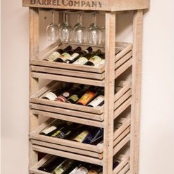 Napa East Vineyard Tall Wine Barrel Rack Cabinet - Show off your prized wines with the Napa East Vineyard Tall Wine Barrel Rack Cabinet, which features a cabinet that is hand-crafted from distressed white oak for an authentic period style finish. The clever racking system is made to resemble old wine crates, which makes this a truly one-of-a-kind table and wine storage unit that hold 24 bottles and 12 glasses. And, the solid wood top is hinged to open for more storage.About Napa EastNapa East creates wine-inspired furnishings that are made from actual reclaimed oak wine barrels. Their barrels began life handcrafted with pride from the finest French and American Oaks, and Napa East continues that theme when they hand-select barrels and giving them new life as beautiful one-of-a-kind works of art.
