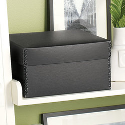 "Exposures - Original Storage Collection Black Shoebox Photo Storage Box - Overview Exposures has been designing museum-quality storage for 20 years, starting with our classic Original Storage Collection. This updated black version provides the same quality youve come to expect in a new color. Our exclusive Shoebox photo storage organizes and protects your valuable memories beautifully. Perfect for safekeeping important documents, photos, magazines and other precious items.  Features Black embossed paper covering Reinforced metal clasps at corners Tested by Library of Congress for archival quality Made in the USA  Specifications Measures 5-5/8""H x 7-7/8""W x 10-7/8""D"