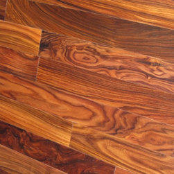 Morado Hardwood Flooring - Morado is a South American wood with a striking dark violet-brown heartwood that is sometimes streaked. It has a medium to high luster, and a texture that can range from coarse to fine. It's grain is interlocked and can be straight or irregular. Highly resistant to decay and fungi, Morado's hardness also contributes to its durability, the wood holding a Janka hardness rating of 1,780. Used for decorative veneers, specialty items, and cabinet work, Morado is wood widely recognized for its beauty, often being used for many of the same purposes of another South American beauty, Brazilian Rosewood.