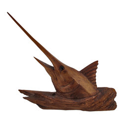 Hand Carved Dark Mahogany Sailfish Figure - This mahogany sailfish is a unique home decor accent that complements beach and nautical themed rooms, perfectly. It has a dark stain, allowing you to appreciate the beauty of the wood grain and color, and the hand carved details give this piece depth and character. It measures approximately 21 inches long, 19 inches tall, 5 1/2 inches wide and looks lovely on bookshelves, mantels, and tables anywhere in your home.
