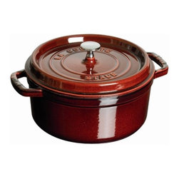 Staub - 7-Qt. Round Dutch Oven - The French oven is a timeless standby for stews, roasts, soups, casseroles and other one-pot classics. Staub has perfected this tradition in our signature ''La cocotte'' (co-cot) French Oven, the choice of some of the world's best chefs. The traditional round design has self-basting spikes for continuous, natural basting. When your meal is ready, La Cocotte moves beautifully from the stove to your table. Features: -Round cocotte.-Material: Cast iron.-Traditional round design has self-basting spikes for continuous, natural basting.-Nickel knob for oven use.-Closed circuit and spikes cooking allows self basting.-Enameled black matte interior provides genuine flavor.-Smooth enamel bottom.-Constant and optimum performance.-Cast iron retains and evenly diffuses heat.-Induction hob compatible.-Perfect for stews, roasts, soups, casseroles and other one-pot classics.-Easy to clean.-Dishwasher safe but it is advised not doing this too often.-Resists up to 500 F.-Compatible with all heat sources.-Staub provides lifetime guarantee.-Made in France.-Capacity: 7-Qt..-Distressed: No.-Country of Manufacture: France.Dimensions: -Dimensions: 5.9'' H x 15'' W x 11.1'' D.