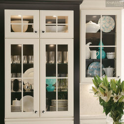 KraftMaid: Onyx Contrasting Back Panel - Adding a contrasting back to the inside of cabinetry adds visual interest and depth.