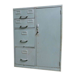 Pre-owned Tower Industrial File Cabinet - This industrial file cabinet offers lots of file and storage, with a built-in lock and keys! It has 2 top index files, 2 large files below and a locker style door with two shelves.  Great for the office, or can be used in the home for linens and toiletries, or whatever your needs may be!