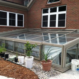 Pit Greenhouse | Kentucky - Solar Innovations, Inc. // Pit greenhouses are extremely energy efficient, as they are essentially a hole dug into the ground with an attached glass structure.