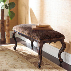 """Kylie"" Cheetah Bench - Add some stylish fun to your home with the ""Kylie"" Cheetah bench featuring a padded seat covered in a whimsical cheetah-print.      * Hand-carved hardwood and laminated lumber.    * Aged antique black finish with gold highlighting.    * Brass nailhead trim around top apron area.    * 40""W x 21.5""D x 18""H."