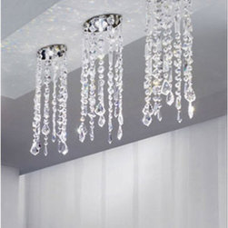 """Axo - Axo Marylin 12 ceiling light - The Marylin 12 ceiling light is designed by Manuel Vivian. This stunning light consists of light reflecting lead crystal strands (available in crystal or black colours) suspended from a canopy in satin nickel finish. Get an exclusive touch into your home. The Marylin collection features various lamp options: suspension lamps, pendant lights, wall sconces as well as floor lamps.  Product description: The Marylin 12 ceiling light is designed by Manuel Vivian. This stunning light consists of light reflecting lead crystal strands (available in crystal or black colours) suspended from a canopy in satin nickel finish. Get an exclusive touch into your home. The Marylin collection features various lamp options: suspension lamps, pendant lights, wall sconces as well as floor lamps.  Details:                          Manufacturer:             Axo Light                            Designer:             Manuel Vivian                            Made in:            Italy                            Dimensions:                         diffuser: 4.7"""" x 2.6"""" (12 x 6.5 cm) x height: 17"""" (43 cm); overall height: 18"""" (47 cm); width of canopy: 2"""" (6 cm)                                         Light bulb:                         1 x 60W max. G9 halogen light bulb (not included)                                          Material:             lead crystal, metal             Designer Manuel Vivian:  Born in Venice in 1971, his interest in design started when he was very young, in particular with reference to blown glass, also thanks to his family business. After succeeding in making the first projects in glass, Manuel enlarged his range of interests to the various fields of Interior Design. Since AXO Light was born in 1997, he has been cooperating constantly with the company and became its main designer."""