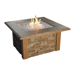 The Outdoor Greatroom - Sierra Square Chat Height Fire Pit With Table - The functional and durable Sierra fire pit table is the perfect addition to any outdoor space. Faux Stack Stone gives a realistic stone finish while a Supercast top and corner pieces add an element of charm and sophistication. The combination of fire and stone is timeless. This fire pit table comes with a matching Supercast buner cover that results in a functional, beautiful gathering place for family and fiends. The square 24x24 inch stainless steel Crystal Fire Burner will truly light up the night and add warmth to your outdoor space. These burners are made from high quality stainless steel and include tempered, tumbled glass, an LP hose and regulator, a metal flex hose, a gas valve, and a push button sparker. With just a push of a button, a beautiful clean-burning fire appears atop a bed of highly reflective Diamond glass fire gems. All burners are shipped with orifices for LP or NG fuels and are UL approved for safety and quality. Adjust the flame height to your desired setting and enjoy the magic and ambience of a warm glowing fire.