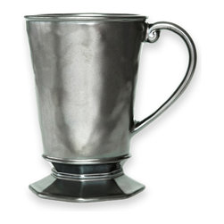 Pewter Stoneware Mug - Amply sized, the Pewter Stoneware Mug holds a steaming cafe au lait, a seasonal hot toddy, or a spiced punch. The lustrous pewter finish adds glamour to a holiday table or a bit of European panache to a more casual dinner setting. The gently curved handle lends refined charm to the sophisticated silhouette.