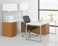"""Rulers.com - HON Voi Small Footprint Layered L-Station   Non-handed   Layering Shelf and Low - Voi mixed-material desking by HON combines the contemporary look of steel, with a cool pale silver and the warmth of woodgrain...using top quality materials and legendary workmanship. This compact L-station requires only 60"""" x 60"""" of floor space while offering 2 locking lateral drawers, 2 non-locking supply drawers and a layering shelf for staging work in progress. It's amazing that a workstation this small can deliver such huge returns. Silver Mesh laminate, Harvest woodgrain laminate and Platinum paint."""