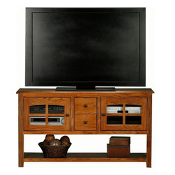 Eagle Furniture Manufacturers - Oak Ridge Entertainment Console w Lower Shelf (Medium Oak) - Finish: Medium Oak. Two drawers. Two glass panel doors. Two adjustable glass shelves. Designed with fluted detailing. Straight leg base. Warranty: Eagle's products are guaranteed against material defects for one year from date of delivery to the dealer. Made in USA. No assembly required. 57 in. W x 16.5 in. D x 32 in. H (96.3 lbs.)The Oak Ridge collection combines American oak hardwood with updated contemporary styling. Heavy crown molding, sleek lines, fluted side molding, black brushed metal hardware, solid oak frames and solid oak recessed doors give this transitional collection a style all its own