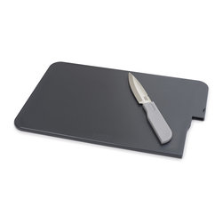 Joseph Joseph - Slice and Store, Grey - The Slice & Store is a unique compact chopping board with an integrated knife, making it convenient for performing most food preparation tasks. The blade is made from high quality Japanese stainless steel and stores away safely after use. This handy set is also perfect for picnics and camping. Dishwasher safe. By Joseph Joseph. Grey. Overall Slice & Store measures 12.6 x 8.66 x 0.3""