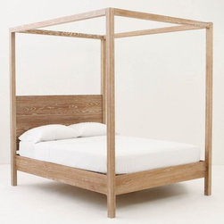Woodland Slumber Canopy Bed, Beige - For a master suite or more formal guest bedroom, I love the idea of using this Anthropologie bed. The four poster style and strong geometric lines remind me of a ship's sleeping quarters.