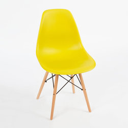 Mid-Century Slope Chair in Mustard - Our Mid-Century Slope Chair is an ingenious design inspired by an iconic manufacturing process of the 1950s and 1960s. The original was born out of technological advancements that allowed a chair to be constructed out of a single mold of fiberglass. With the original mold no longer in production, today's designers have improved this process even further, resulting in a comfortable, stylish, lightweight chair. Replacing fiberglass with more eco-friendly polypropylene, the current iteration takes this incredible design and makes it accessible and modern, featuring a smooth polypropylene seat that contours to your body. This chair is also one of our most versatile pieces, fitting in at the dinner table, conference table, or anywhere else you're looking to add some seating.
