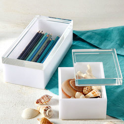 White Acrylic Boxes - Set of 2 - Excellent for updated desktop storage or for transitional specimen display, these decorative yet functional boxes are made from clear and opaque white acrylic, shaped into simple, geometric block forms with transparent lids so the contents are fully visible.  Even fundamentals of your bath, vanity, or desktop become part of a gallery display with these clever containers.