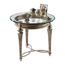 Magnussen Furniture - Round Glass Top End Table - Galloway - Finish: Subtle gold with dark burnishing. Timeless and elegant, crafted of cast resin and wrought iron. Galloway's table aprons feature a rope twist design bordering an egg and dart design. Fluted tapered legs are finished with decorative floral pucks resting under 10mm glass tops. 28 in. W x 28 in. D x 24.375 in. H