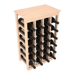 24 Bottle Kitchen Wine Rack in Pine - Petite but strong, this small wine rack is the best choice for converting tiny areas into big wine storage. The solid wood top excels as a table for wine accessories, small plants, or whatever benefits the location. Store 2 cases of wine in a space smaller than most televisions!