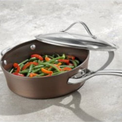 Calphalon - Calphalon Contemporary Nonstick Bronze Anodized Saute Pan with Lid - 1877056 - Shop for Sauce and Saute Pans from Hayneedle.com! The Calphalon Contemporary Nonstick Bronze Anodized Saute Pan with Lid features a wide flat bottom for ample cooking surface plus deep straight sides to keep the food where it belongs - in the pan. And this isn t any old saute pan - the bronze color is the result of the hard-anodized heavy-duty aluminum crafted through an enhanced process. Plus the three-layer PFOA-free nonstick is like a dream come true and the cast stainless steel handle stays cool even when the pan is hot. Dishwasher safe and oven safe up to 450 degrees Fahrenheit. Available in your choice of three- or five-quart. Includes manufacturer s lifetime warranty.About CalphalonCalphalon's mission is to be the culinary authority in kitchenwares enhancing the home chef's food experience during planning prep cooking baking and serving. Based in Toledo Ohio Calphalon is a leading manufacturer of professional quality cookware cutlery bakeware and kitchen accessories for the home chef. Calphalon is a Newell-Rubbermaid company.Calphalon's goal is to give you the home chef all the tools you need to realize your highest potential in the kitchen. From your holiday roasting pan to your everyday fry pan count on Calphalon to be your culinary partner - day in and day out for breakfast lunch and dinner for a lifetime.