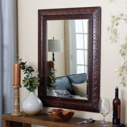 Uttermost Rowena Rectangle Mirror - 30W x 42H in. - What We Like About This MirrorWith a look of fine aged leather our Rowena Mirror reflects the relaxed luxury of your home. Genuine copper panels are deeply embossed with intricate patterns for a detailed design element. A heavily distressed mahogany wood tone adds a casual touch. Antique gold accents and a light glaze lend a soft gleam to this spectacular mirror. Glistening beveled glass creates the perfect contrast to rich colors. Ideal in the entryway or dining room our rectangular Rowena Mirror enhances any space with its intensity.