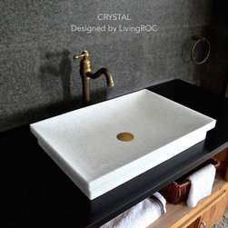 """Living'ROC - 24"""" Pure Crystal White Marble Bathroom Vessel   Drop-in Sink - CRYSTAL - Description Both vessel or drop-in CRYSTAL is a rectangular pure White bathroom single vessel sink - 23.3' x 15.7' x 3.5' - genuine interior decoration pure genuine crystal white marble. The 'Exceptional' cut in the block without any comparison with plastic and other chemical resin market often unaffordable.  You will definitely not let anyone feel indifferent with this 100% natural stone unique in the US and exclusively available on Living'ROC.net.  Feel free to click on our facebook portfolio page to inspire yourself with our clients' projects...Simply our living'ROC style. Discover the well-being and the restful feeling CRYSTAL can give you. This model is one of our Bathroom range star. Its slim and sleek lines invite calm and serenity. Its four sloping edges allow a large amount of water. This creation will give your bathroom a minimalist still elegant look. At LivingRoc we have chosen the most beautiful stones. All our basins are made from high quality pure genuine materials that will last for years to come. Marble is a material perfectly adapted to bathroom use. All of our vessel sinks are the creation of a combined group of talented masons dedicated to the idea of creating bathware made from natural material which is environmentally friendly. Waterproofed CRYSTAL is ready to use sitting on a vanity counter top.   Our creation is delivered without an overflow drain (not included) - every US drains models you can find on the market will fit perfectly on Living'ROC vessel sink. This model is ready to use over the countertop. The photos you see online have been taken with extreme care by our Founder CEO - Florent LEPVREAU because without them we would not be one of the natural stone business key player of the online European continent. Once you have encountered the product in your home you will always have pure happiness for the love of the materials. It will be beyond your expe"""