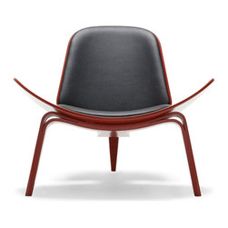 Hans Wegner - Hans Wegner Shell Chair   Smart Furniture - CH07 Shell Chair  from Carl Hansen & Son   designed by Hans Wegner  Introduced in 1963, the Shell Chair was skeptically met at first. After being shelved after a few limited editions were produced, the Shell Chair was relaunched in 1997 and finally got the attention it so obviously deserves. Then, as if to prove its popular acceptance and pedigree, one of the original Shell Chairs from the 60's sold for $20,000 at Christie's in London in 1999.  Seat and back are made of form-pressed plywood shells. The 3 legs are also made from laminated plywood - the 2 front legs are one continuous piece that wraps under the seat, and the rear leg is a separate piece. To enhance the chair's comfort, Wegner added 2 upholstered cushions which are fastened to the shell with screws from the back and bottom. You'd think that a 3-legged chair would be a mite unstable, but that's simply not the case. The Shell Chair is quite stable - even stable enough to allow its occupant