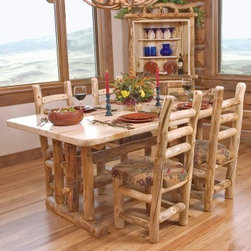 Mountain Woods Furniture - Log Dining Room Table, Heirloom Collection - A  log  dining  table  or  log  kitchen  table  perfect  for  the  breakfast  nook  or  even  for  refreshing  breakfasts  on  the  patio.  This  rustic  dining  table  is  crafted  from  locally  harvested  aspen  logs.  It  includes  a  1.75-inch  solid  wood  top  and  is  hand-finished.  Enjoy  the  sheen  of  natural  wood  as  you  gaze  out  of  the  windows  and  sip  your  morning  coffee.  The  solid  wood  top  features  the  natural  curve  of  the  log  along  the  longest  edge.  Matching  chairs  are  available.                  Solid  wood              Hand-finished  with  3  coats  of  water-based  polyacrylic.              Mortise  and  tenon  joinery              Kiln-dried  wood              Available  with  Trestle  Base  or  Leg  base              Available  in  natural  finish,  or  slightly  darker  bronze  aspen  finish              Chairs  may  be  purchased  separately              Free  curbside  shipping  within  contiguous  48  states              Allow  4-6  weeks  for  shipping                Log  Dining  Table  Pricing                                        Table  Length                      Dimensions                      Price                                      4  Feet  (48  Inches)                      48  W  x  36  L  x  30  H                      681.00                                      5  Feet  (60  Inches)                      60  W  x  39  L  x  30  H                      808.00                                      6  Feet  (72  Inches)                      72  W  x  42  L  x  30  H                      1199.00                                      7  Feet  (84  Inches)                      84  W  x  45  L  x  30  H                      1455.00                                      8  Feet  (96  Inches)                      96  W  x  48  L  x  30  H                      1670.00                                       Log  Table  Options  and  Upgrades                                                    Log  Table  with  Trestle  Base             (72-inch  table  shown)                                   Log  Table  with  Leg  Base             (48-inch  table  shown)                                                  Bronze  Aspen  Stain  Color                                  Natural  Stain  Color