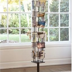 "Floor-Standing Photo Carousel, White - Styled like an old-fashioned postcard rack, our rotating metal carousel has open photo display slots for 20 photos but holds many more. 11"" diameter, 60"" high Rotate photos from front to back to create an ever-changing display. Holds 4 x 6"" photos and cards. Available in bronze and white. Catalog / Internet Only."