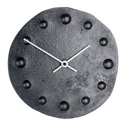 Form & Reform - Lunar Clock - You'll be happy with this steel wall clock — reminiscent of a sundial — in any room in your home. Its stylish face is pressed under heat and pressure to lend it a dark, forged color and texture.