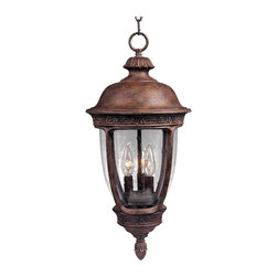 Maxim Lighting - Maxim Knob Hill DC Outdoor Hanging Lantern - 26.5H in. Sienna Multicolor - 3468C - Shop for Pendants and Hanging Fixtures from Hayneedle.com! The Maxim Knob Hill DC Outdoor Hanging Lantern is ideal for traditional decors and perfect for use on porches patios or beside front doors. Designed to hang from the ceiling this fixture comes complete with chain and has subtle leaf-and-vine details which give it the look of a bygone era. It is made of cast aluminum and seedy glass and finished in a rustic Sienna color. Rated for outdoor use; bulbs not included.About Maxim LightingSince 1970 Maxim Group Companies headquartered in California have been committed to providing a diverse selection of high quality lighting fixtures for your home. Maxim products are made with attention to detail and with all the latest advances in lighting technology as well as forward-thinking design policies that fit effortlessly into your life. Maxim's goal is to lead the lighting industry through integrity innovation and client satisfaction.