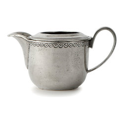 Anna Caffe Creamer - Stamped with a pattern inspired by festive vintage fabric trims, the Anna Caffe Creamer pays elegant homage to upscale adornment but looks sensible and sophisticated on the table. Its wide spout and simple handle are perfect for pouring and uncomplicated in silhouette. Made from authentic pewter, this simple everyday creamer was handcrafted in Italy.