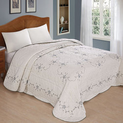 None - Colette Bedspread - Update your bedroom with an embroidered bedspread that is handmade in China and has a delicate blue-and-green floral design. The material on the bedspread is a brushed microfiber,with a solid color on the other side of the bedspread.