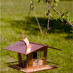 H. Potter - H. Potter Wacky Bird House - GAR483 - Shop for Houses from Hayneedle.com! The H. Potter Wacky Bird House is like a vacation home to accommodate the frequent visits from your aerial companions. With a whimsical flair this 100 percent copper bird house is both durable and a wonderful variant of garden art. Making this bird house further appealing are life-like details like four-paned windows a smoking chimney and a porch where the birds feed. A porch railing doubles as a space where birds can be comfortably perched as they feed. Accommodating the bird feed is a wonderful glass reservoir.About H. Potter ProductsOver the past nine years H. Potter has continually enhanced all aspects of their business to fill the desires of their growing list of satisfied customers. With the entrance of 2006 they were able to offer over 100 impressive designs. Not only are they always striving to bring you products that are new bold and unique but they also work hard to increase the overall quality of the items. They do this by incorporating heavier materials stainless steel hardware and dramatically expanding their copper container business. H. Potter artisans design many 100% hand-made pieces to fit effortlessly into your home or garden setting.