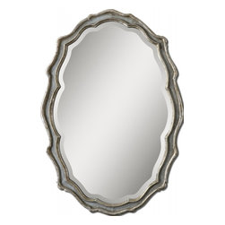 "Uttermost - Dorgali Aged Slate Blue with Silver Leaf Mirror - This curvaceous mirror features a frame finished in aged, slate blue accented with antiqued silver leaf details and a light gray wash. Mirror has a generous 1 1/4"" bevel. May be hung horizontal or vertical."