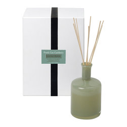 Fresh Cut Gardenia / Living Room Diffuser - 15 oz. - A classic, sought-after floral scent with a noticeable note of deep green foliage evokes elegance, tradition, and the enduring hope of spring no matter where you place the Fresh Cut Gardenia Diffuser or what season you use it to enhance. A deep, sophisticated moss green suffuses the glass of the bottle that holds the home fragrance oil for this elite reed diffuser.