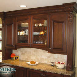 Kitchens - Cherry buffet with columns and capitals and swooped doors. Wavy glass panels in middle doors by Anliker Custom Wood, Ltd.