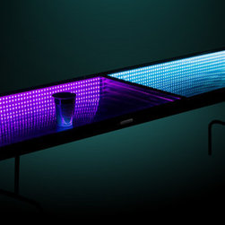 InfiniGlow - The InfiniGlow Table that uses special glass to cast light into what appears to be endless space. No other standard Beer Pong table comes close to the awesomeness of this table. For the party enthusiast or simply make an impression. This table will be the center-piece of your parties no matter if its a kickback or a Halloween party! Pick your team colors or use one of the 19 color patterns. Folding center for portability or storage. Light up the party.