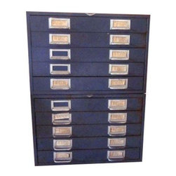 "Pre-owned Vintage Industrial Flat File Metal Cabinets - A set of 2 large vintage Cole Steel flat filing cabinets, each containing 5 drawers with 2 compartments - totaling 10 drawers and 20 compartments. We've seen similar filing cabinets in magazines and on design blogs recently, as an Industrial coffee table, or in a craft room or office storing supplies. The pair has not been cleaned up, and have rusty spots, dings and chips which we think add to the charm.    Measurements:  18 3/4"" across  16 1/8"" deep  12 1/2"" tall each or when placed upon each other, 25"" tall"
