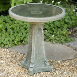 Campania International - Galway Bird Bath - B-118-NA - Shop for Garden Bird Baths from Hayneedle.com! Beautifully designed from cast stone the Galway Bird Bath is a combination of simple elegance and lasting function. The round 18.5-inch-diameter bowl easily accommodates multiple birds and is supported on a carved pedestal with stylish flared base. The hand-applied multi-step finish replicates the look of natural aging and comes in a choice of patinas to complement your outdoor decor. Recommended care: Proper maintenance is recommended to protect this product from the freeze-thaw cycles that occur in winter. Do not leave the bird bath top outside in winter because once the top fills with water/snow and freezes the top may crack. The bird bath base should be raised up off the ground in winter so it will not freeze to the ground surface.About Campania InternationalEstablished in 1984 Campania International's reputation has been built on quality original products and service. Originally selling terra cotta planters Campania soon began to research and develop the design and manufacture of cast stone garden planters and ornaments. Campania is also an importer and wholesaler of garden products including polyethylene terra cotta glazed pottery cast iron and fiberglass planters as well as classic garden structures fountains and cast resin statuary.Campania Cast Stone: The ProcessThe creation of Campania's cast stone pieces begins and ends by hand. From the creation of an original design making of a mold pouring the cast stone application of the patina to the final packing of an order the process is both technical and artistic. As many as 30 pairs of hands are involved in the creation of each Campania piece in a labor intensive 15 step process.The process begins either with the creation of an original copyrighted design by Campania's artisans or an antique original. Antique originals will often require some restoration work which is also done in-house by expert craftsmen. Campania's mold making department will then begin a multi-step process to create a production mold which will properly replicate the detail and texture of the original piece. Depending on its size and complexity a mold can take as long as three months to complete. Campania creates in excess of 700 molds per year.After a mold is completed it is moved to the production area where a team individually hand pours the liquid cast stone mixture into the mold and employs special techniques to remove air bubbles. Campania carefully monitors the PSI of every piece. PSI (pounds per square inch) measures the strength of every piece to ensure durability. The PSI of Campania pieces is currently engineered at approximately 7500 for optimum strength. Each piece is air-dried and then de-molded by hand. After an internal quality check pieces are sent to a finishing department where seams are ground and any air holes caused by the pouring process are filled and smoothed. Pieces are then placed on a pallet for stocking in the warehouse.All Campania pieces are produced and stocked in natural cast stone. When a customer's order is placed pieces are pulled and unless a piece is requested in natural cast stone it is finished in a unique patinas. All patinas are applied by hand in a multi-step process; some patinas require three separate color applications. A finisher's skill in applying the patina and wiping away any excess to highlight detail requires not only technical skill but also true artistic sensibility. Every Campania piece becomes a unique and original work of garden art as a result.After the patina is dry the piece is then quality inspected. All pieces of a customer's order are batched and checked for completeness. A two-person packing team will then pack the order by hand into gaylord boxes on pallets. The packing material used is excelsior a natural wood product that has no chemical additives and may be recycled as display material repacking customer orders mulch or even bedding for animals. This exhaustive process ensures that Campania will remain a popular and beloved choice when it comes to garden decor.Please note this product does not ship to Pennsylvania.