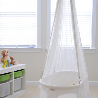 Dreambur Designer Hanging Bassinet - This hanging bassinet can be hung from a hook or moved from room to room. It creates such a dreamy little nap space — I just wish they made one big enough for momma!